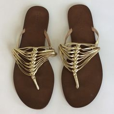 Ann Taylor sandals Super cute Ann Taylor thong sandals. Gold with brown bottoms. Leather upper. Preloved condition with minor signs of wear. Size 8. Ann Taylor Shoes Sandals