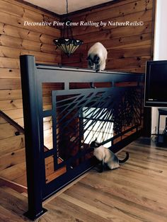 #Modern #Staircase #Railing with Pine Cone and custom welding. We build each rail to fit your style & spaces. Visit our website for more ideas at www.NatureRails.com (Cats are optional.)