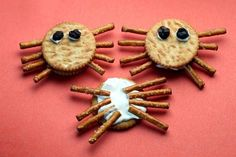 Spiders made with Ritz crackers, pretzel sticks, cram cheese and raisins. Easy for kids to make