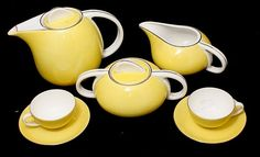 COFFEE SERVICE  Porcelain molded in relief of Vista Alegre, decoration with silver ribbon on yellow background with coffee, milk and six cups and saucers, mark used in 1922/47.