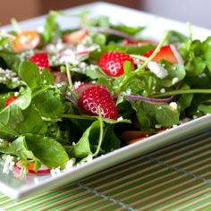 Peppery arugula, crisp radishes, sweet strawberries, and tangy goat cheese are the stars of this simple and nourishing salad for one.