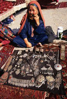 Turkmenistan | A woman sells jewelry at the Ashkhabad Sunday bazaar market. | © David Samuel Robbins/Corbis