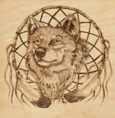 This artist used wood and wood burning techniques to create this composition of a wolf. The texture of the wooden surface and wood burning gives this work almost an antique like feel and makes the fur pop out some.