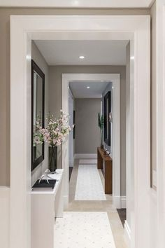 Modern contemporary hallway design and decor idea. Grey walls, white trim in hallway and recessed LED lighting. Decorating a modern stylish hallway with sideboards and accessories. Contemporary Hallway, Modern Hallway, Contemporary Home Decor, Contemporary Lounge, Long Hallway, Home Interior Design, Interior Decorating, Interior Photo, Interior Doors