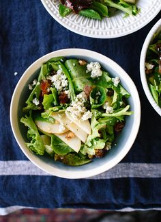 This fresh green salad with pears, walnuts, dates and blue cheese is a fresh option for your holiday table! cookieandkate.com