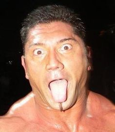 David Michael Bautista Jr. being totally adorkable.This pic always makes me laugh and BTW his tounge is HUGE !.