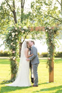 outdoor ceremony. asymmetrical floral arrangement.