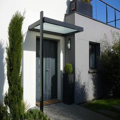 Outside # Outside Even though early in thought, the actual pergola have been having a Modern Entrance Door, House Entrance, Entrance Doors, Outdoor Wall Lighting, Outdoor Walls, Modern Exterior, Exterior Design, Front Door Canopy, Door Canopy Kits