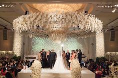 Venue: Beverly Wilshire Planner: International Event Company Event Design/Catering: The Olympic Collection Florist: Marks Garden Room Draping: Edge Design Decor Rentals: Harry's Party Rentals Band: West Coast Music DJ: DJ Yossi, 90210 Entertainment Sound: Design Sound Photographer: John Solano Photography Videography: Vidicam Lighting: Images by Lighting Cake: Joanie and Leigh's Cakes Phalaenopsis Orchid, Orchids, Reception Seating, Backdrop Decorations, Event Company, Chuppah, Ceremony Backdrop, Photography And Videography, Most Romantic