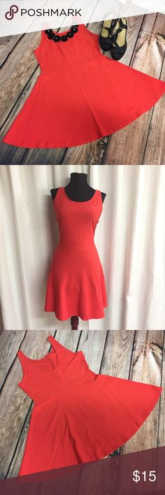 Red Dress Every lady needs a little red dress and this one is perfect. It's 31 1/2 inches long with a 14 1/2 inch waist. It's stretchy and so comfy. Add your favorite necklace and you'll look amazing. Divided Dresses