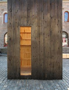 The charred exterior of this temporary pavilion in Bergen, Norway, references 16 major fires that have taken place in the city since the twelfth century.