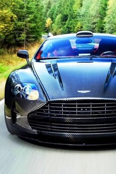Aston Martin DB9 kitted out in Mansory carbon fibre.
