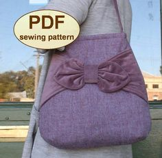 """Inspired by the simple elegance of 1940s fashions but with a modern twist, the """"Village Post"""" Bag pdf sewing pattern is easily constructed with dart shaping, shoulder strap, bow front panel trim an..."""