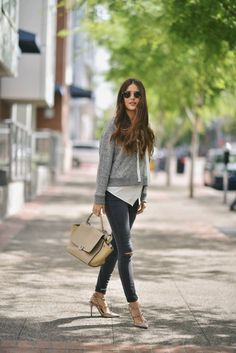 Paola Alberdi is rocking the hottest new spring trend; the lace up sweater! By pairing this cute grey sweater with jeans and a neutral bag and heels, Paola has created a simple but stylish spring look which we love. Copy this look & pair it with sneakers or heels depending on the occasion. Outfit: Neiman Marcus, Shoes: Valentino.