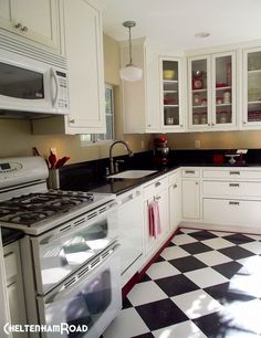 I love the black and white floor and the finished look of this remodeled kitchen.