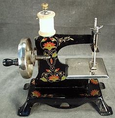 vintage toy sewing machine - I have the one my Mom bought me sans the flowers - still in the original case!!!!