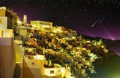 photographer: ben heine: fira by night: santorini, greece