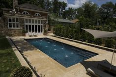 pool with limestone  | Inground Swimming Pool With Limestone And Deck Jets