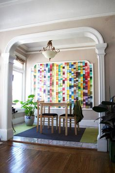 This mural inside wall molding is made from paint-store chips - a beautiful piece of modern art with a made-by-hand touch