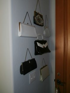 Vintage purses at office entry.