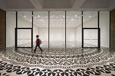 Wheel of Everyday Life, Rice Gallery, Houston, Texas, USA, 2013. A large-scale, circular pattern in self-adhesive vinyl on floor and windows. Rice Gallery