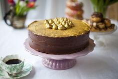 """Gold Dust Chocolate Cake: Donal is a young popular Irish chef and he said, """"I was quite excited to put together this selection of sweet treats for the April issue of Food & Wine Magazine.  The hero of the shoot was without a doubt this wonderful chocolate cake dusted with edible gold powder.""""  He neglected to mention those gold """"kisses"""" on top?"""