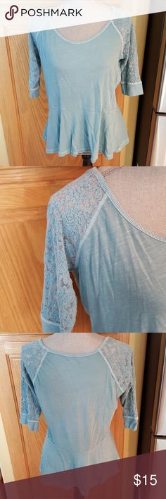 """Icy Blue Drop Waistline Tee w/lacy sleeves Beautiful icy blue shade!  Raglan style tee with scooped neckline,  dropped waist and lacy 3/4 length sleeves. So feminine,  casual, and cute. Excellent quality and condition. Arm pit measurement is 20.5"""".   Bundle discount available.  Non smoking home. All reasonable offers accepted. Arizona Jean Company Tops Tees - Short Sleeve"""