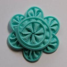 Zipper flower tutorial ... http://shopcraftwarehouse.blogspot.com/2011/08/design-team-member-blog-assignment.html