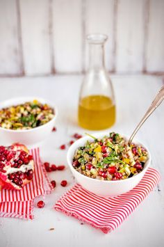 {Quinoa salad with pomegranate, spinach and avocado.}