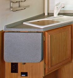 Need extra counter space in your RV glamper? Collapsible shelf turns into extra counter space - that's glamping-tastic!