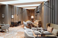 The light fixture is really an interesting idea!   Das Stue Hotel Interior by Patricia Urquiola