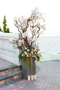 Pale Pink Floral and Branch Ceremony Arrangements