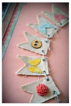 These mini banners are a great way to use up small scraps and leftover trims. (also w/ paper scraps and embellishments)