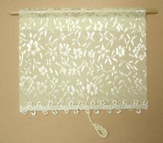 "White floral window shade. Miniature shade is 2 1/2"" wide and 2 1/8"" long, not counting the hanging pull."