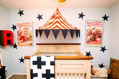 Ikea hack on the circus tent and vinyl stars add a big wow to the room