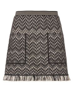 Missoni EXCLUSIVE Fringe Knit Mini Skirt: Our exclusive version of the swinging fringe detailed mini skirt designed of signature Missoni knit. Elastic waistband. Two patch pockets at front. Lined. In black/sand. Fabric: 60% wool/38% rayon/2% nylon Trim: 50% rayon/50% wool Lining: 100% polyester ...