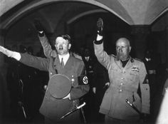 Benito Mussolini and Adolf Hitler saluting