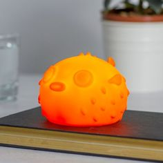 Meet Pablo the Pufferfish Nightlight. He's cute. He's orange. He's wireless. He emits a powerful orange glow and fits perfectly in the palm of your hand. Pablo