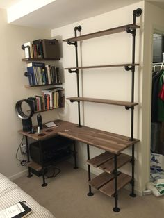 Image result for shelving with lumber and table area