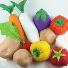 "felt vegetables ... make a little container of felt dirt with slots to ""plant"" these in"