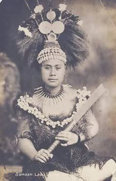 Samoan princess or taupou in traditional dress. She is holding a Nifo Oti or Tooth of death club for authority and power which is also sometimes used for dancing.
