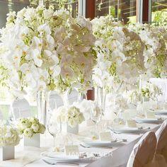 White orchid table centerpieces. Wedding Planner @luxuryeventsphuket