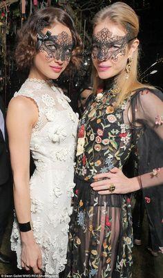 Floral fancy: Olga Kurylenko and Natalia Vodianova were the bells of the ball...
