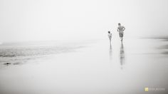 running into the beach fog fine art black and white image by Beira Brown on the CMpro Daily Project, a group photography blog for female photographers