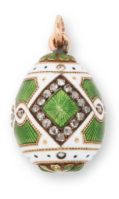 *A FABERGÉ JEWELED GOLD AND GUILLOCHÉ ENAMEL EASTER EGG PENDANT, WORKMASTER MICHAEL PERCHIN, ST. PETERSBURG, 1898-1903 enameled in translucent green over an engine-turned ground within diamond-set borders and an opaque white ground, struck with workmaster's initials, 56 standard height 5/8 in. (1.5 cm)