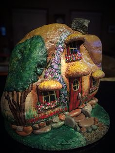 One of my hand painted rock houses I finished recently More