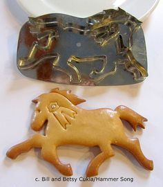 """""""MY PRIZE PONY"""" COOKIE CUTTER. A FAST SPIRITED PONY SPORTS A WAVING MANE AND TAIL AND BRISK TROT, SO PROUD OF HIS RIBBON-MAKE IT BLUE OF COURSE! ORIGINAL DESIGNS BY BILL AND BETSY CUKLA. THIS CUTTER WAS MADE IN HONOR OF BETSY'S PRIZE WINNING PONY HUNTER MARE-MISTY. SEE THE COMPLETE LINE OF HAMMER SONG COOKIE CUTTERS AT LA CUISINE, THE COOKS RESOURCE, IN OLD TOWN ALEXANDRIA, VA."""