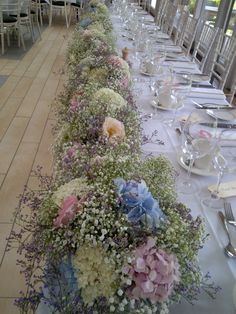 Top table garland. May be a little wide. Replace the pink flowers and purple flowers with white babys breathe sprayed blue.