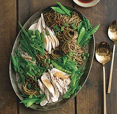 Easy Basil Chicken Salad w/ Soba--tossed with a spicy, fresh basil pesto and used as a base for a shredded chicken and snow pea salad, topped with a piquant dressing for an easy, meal-in-one dish. (via FineCooking)