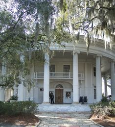 Crescent House in Valdosta, Georgia // Built in 1898 by U.S. Sen. William Stanley West, Crescent House is Valdosta's best-known landmark. The house gets its name from the circular veranda with 13 massive columns, each representing 13 original American col